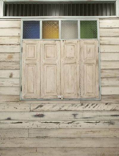 "old style wooden windows"" Window Old Window Old-fashioned Vintage Stained Glass Classic Tradisional House Architecture Close-up Building Exterior Built Structure Closed Locked Wooden Latch Textured  Weathered Lock"
