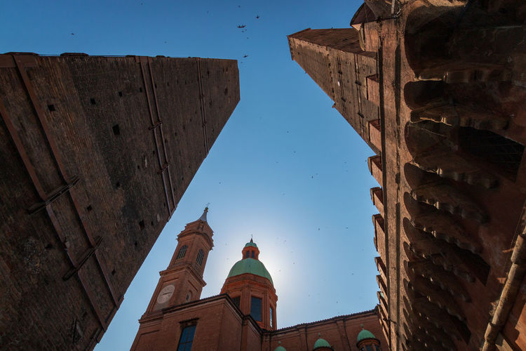Low angle view of two towers asinelli and garisenda in bologna, italy