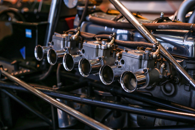 Business Car Close-up Engine Equipment Focus On Foreground In A Row Indoors  Industrial Equipment Industry Machine Part Machinery Metal Mode Of Transportation Motor Vehicle No People Pipe - Tube Production Line Selective Focus Shiny Silver Colored Technology Transportation