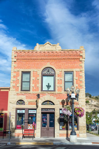 RED LODGE, MT - SEPTEMBER 8: Facade of a historic brick building in Red Lodge, MT on September 8, 2015 Architecture Beartooth Beartooth Mountains Blue Brick Brick Building Building Cloud Clouds Main Street Montana Red Lodge Red Lodge, Montana Sky Tourism Town Travel Travel Destinations USA
