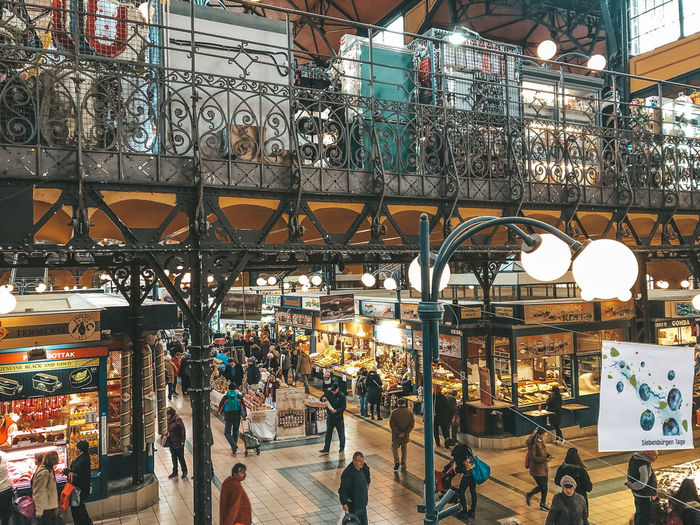 Budapest market Architecture Group Of People Market Women Built Structure Real People Men Crowd Large Group Of People City Lifestyles Illuminated Building Exterior Retail  Adult Lighting Equipment City Life Store Leisure Activity Outdoors Consumerism Budapest Hungary Budapest Market Market