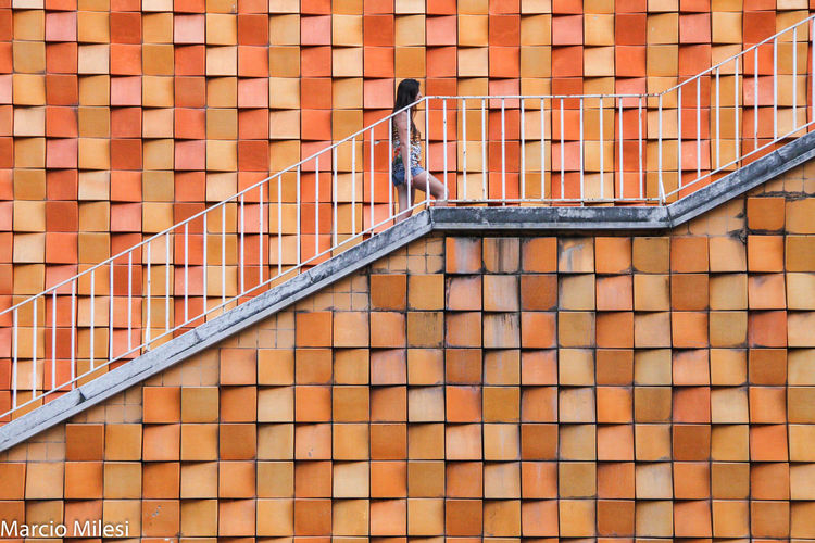 #climb #geometry #handrail #mosaic #staircase #transition #way #woman Architecture Building Exterior Built Structure Day