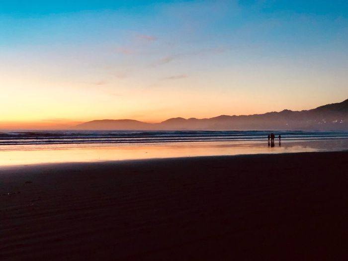 Water Sky Sea Beach Land Scenics - Nature Beauty In Nature Tranquility Tranquil Scene Copy Space Silhouette Nature Sunset Real People Incidental People Unrecognizable Person Idyllic Two People Mountain Outdoors