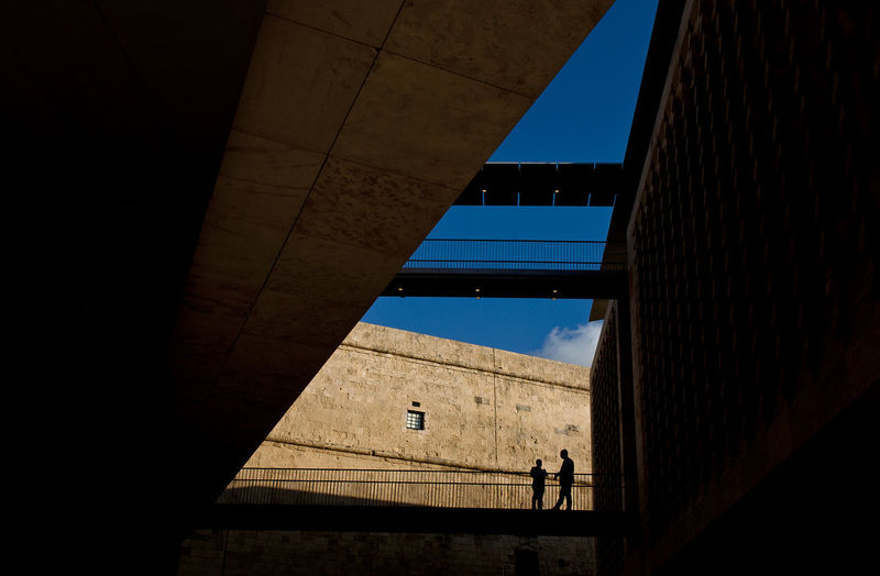 Malta Architecture Built Structure Building Exterior Real People Outdoors Sky Men Lifestyles Building Low Angle View Standing Incidental People Silhouette Two People Valletta Mediterranean  Parliament Building Renzo Piano Day The Architect - 2019 EyeEm Awards