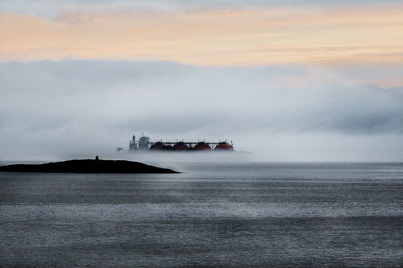 Oil container ship on sea during foggy weather