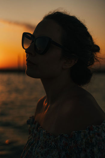 Portrait of woman at beach during sunset