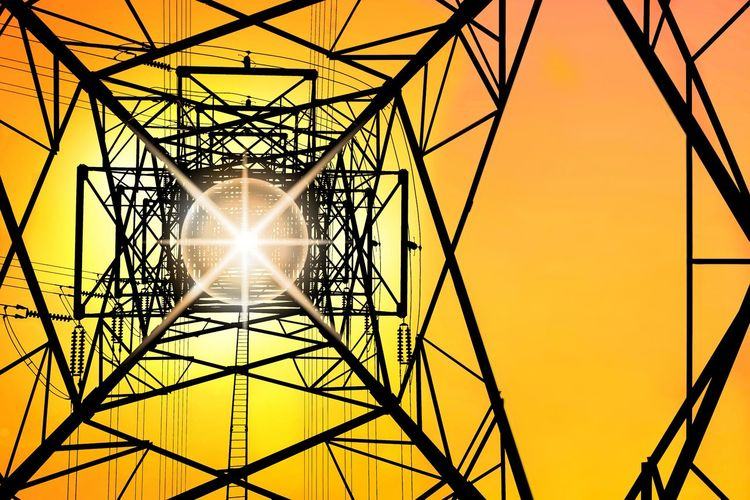 Silhouette ant eyes view of high voltage tower structure with power lines against colorful sunrise sky background, technology concept Shining Metal Steel Electrical Ant Eyes View Low Angle View Colorful Structure Industrial Shadow Geometric Shape Pattern Sunlight Sunshine Technology Electricity Pylon Global Communications Girder Sunset Steel Electricity  Silhouette Cable Fuel And Power Generation Electrical Grid Tower Sunbeam Tall - High Power Cable