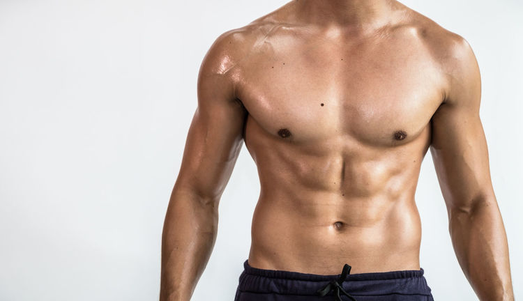 Close up bodybuilder muscular beautiful body on copy space background BodyBuilder Exercise Adult Bicep Chest First Eyeem Photo Fitness Gym Healthy Model Muscles Muscular Muscular Build Sixpack Standing Strength Strong Studio Shot Trainning White Background Workout