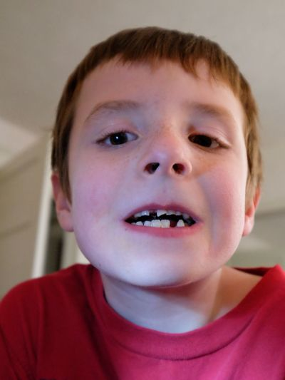 Portrait of boy showing gap tooth