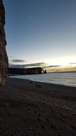 étretat Beach Ocean Cliff Cliffs Rock Rocks Water Moon Sunset Sky Skyporn Clouds And Sky Clouds