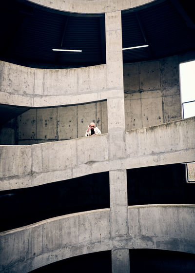 Low angle view of man on multi storey carpark