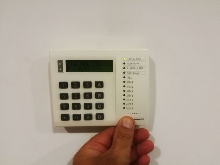 Button Close-up Control Human Body Part Human Finger Human Hand Indoors  One Person People Programmable Push Button Real People Setting Technology Thermostat White Background