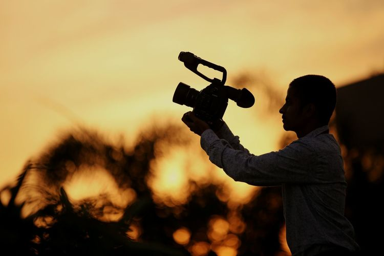 Sunset Technology Men Silhouette Standing Holding Filming Arts Culture And Entertainment Sky