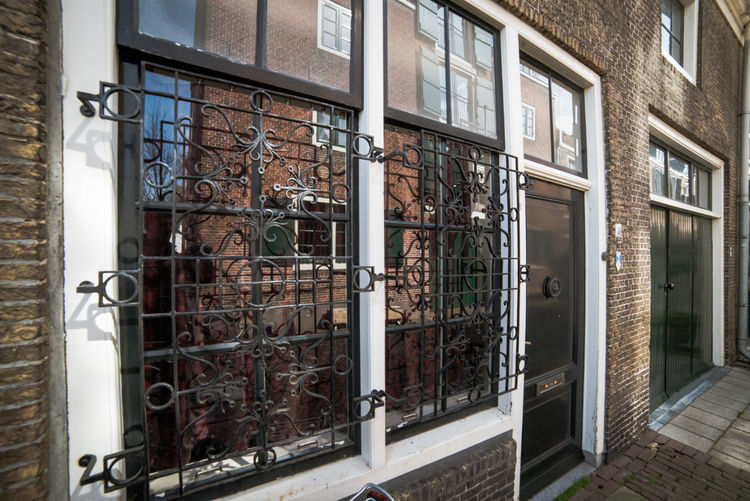 Windows Architecture Building Exterior Built Structure Window Building Entrance Day Door Safety Metal No People Residential District House Outdoors Security Glass - Material Open Protection Railing Wall - Building Feature Wrought Iron