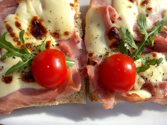 Sandwiched With Cheese And Cherry Tomatoes On Top