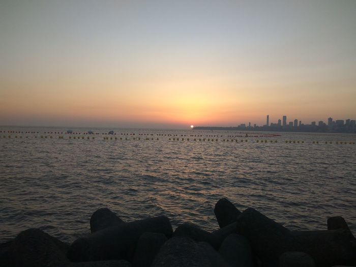 Sunset Sea Travel Destinations Horizon Over Water Travel Vacations Beach Human Body Part Water Tourism Outdoors Scenics Beauty In Nature Large Group Of People Nature Sky People Urban Skyline Adults Only Day