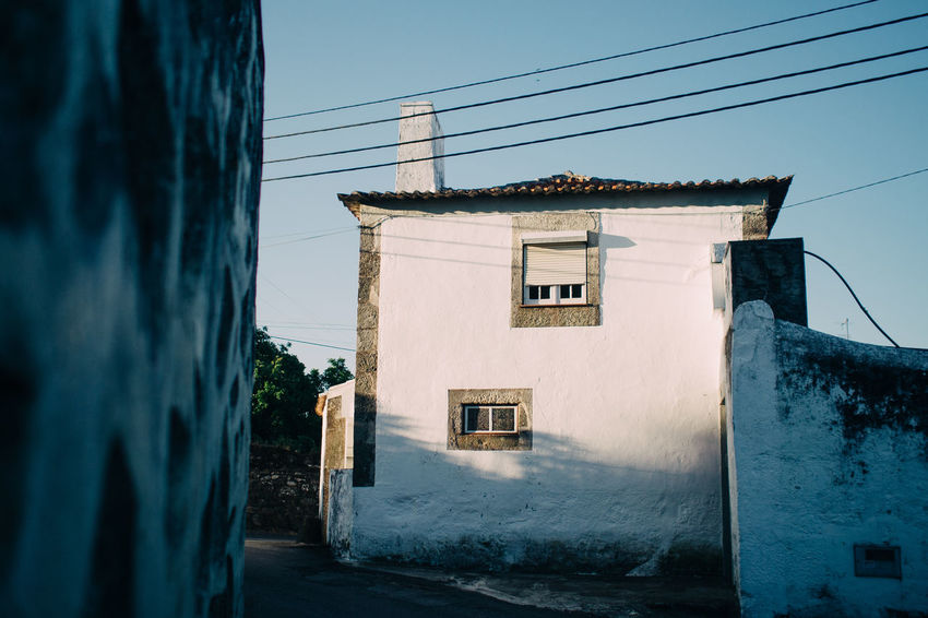 smalltown house Modern Hospitality Architecture Blue Building Built Structure Cable Day Hikinggalicia House Narrow Nature Outdoors Residential Building Residential Structure Sky Sunny The Way Forward Town