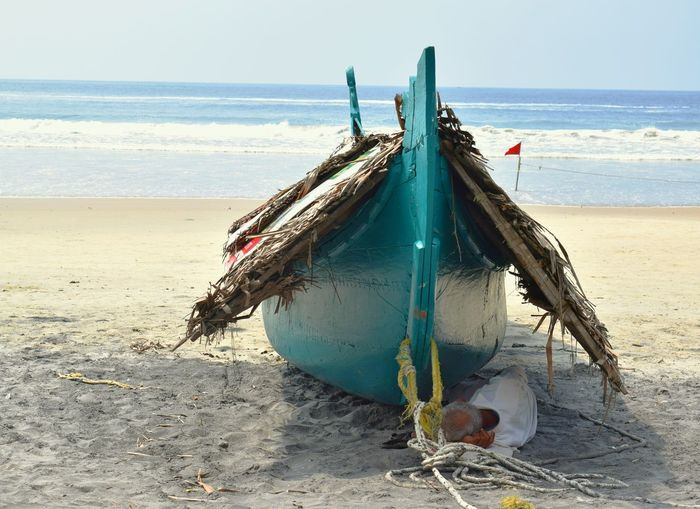 Time to rest.... Boat Beach Sea Sand Earning For Living Hope Daily Life Hard Work Random Shots Sand & Sea Real People Kerala The Gods Own Country ;) Randomclick Wave Shore Clear Sky Outdoors Nature Shadow Resting Time Tiredness Red Flag Family Man Fishermen's Life