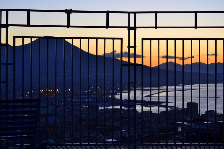 Colors Naples Vesuvio View Architecture Bridge - Man Made Structure Building Exterior Built Structure City Cityscape Day Dusk Nature No People Outdoors Railing Sea Sea And Sky Silhouette Sky Sun Sunlight Sunset Sunshine Suspension Bridge