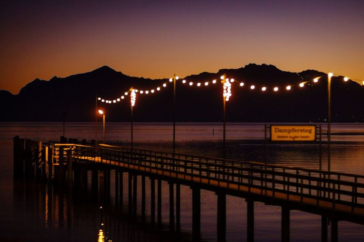 Pier over lake chiemsee at night