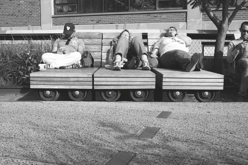People Resting Rails Sundeck Wheels