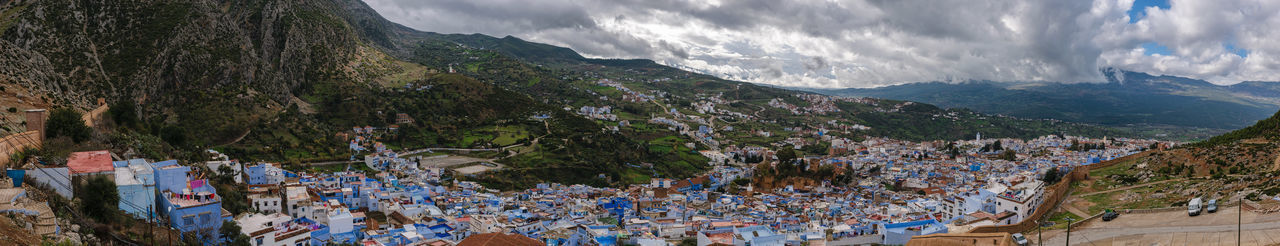 An awesome panoramic view over the blue painted and famous city Chefchaouen in Morocco. It is located in the Rif Mountains. The sky is cloudy. Africa Architecture Background Berber  Blue Chaouen Chefchaouen City Culture Medina Morocco Mountain Nature Old Panorama Panoramic Panoramic Rif Rif Mountains Scenics Sky Street Town Travel View