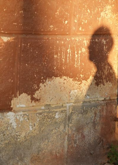 Close-up portrait of a person holding wall