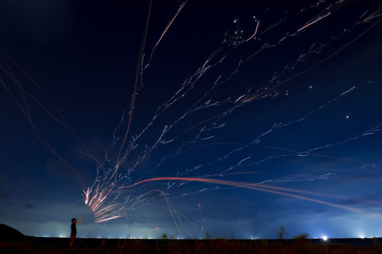 Scenic View Of Man And Firework At Night