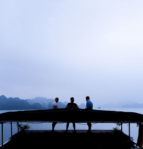 Adult Adults Only Blue Day Friendship Ha Long Bay Ha Long Bay Cruise Housebo\oat Leisure Activity Only Men Outdoors People Railing Sky Standing Subdued Three Amigos Three Guys Togetherness Tourism Tourists Travel Two People View Young Adult Miles Away