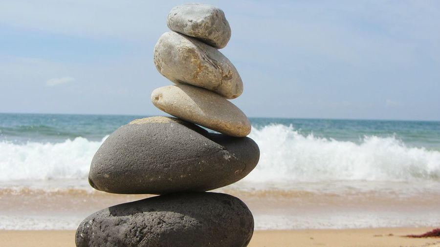 Stacking stones on beach