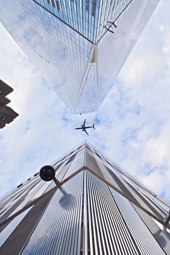 Flying Sky Low Angle View Skyscraper Tower Tall - High Capture The Moment Enjoying The Sights Places I've Been Built Structure Enjoy Enjoy Life Enjoying Life Enjoying The Moment Enjoying The View Architecture Outdoors NYC Photography Freedomtower Freedom Tower WTC Memorial WTC Looking Up Airplane Cloud - Sky
