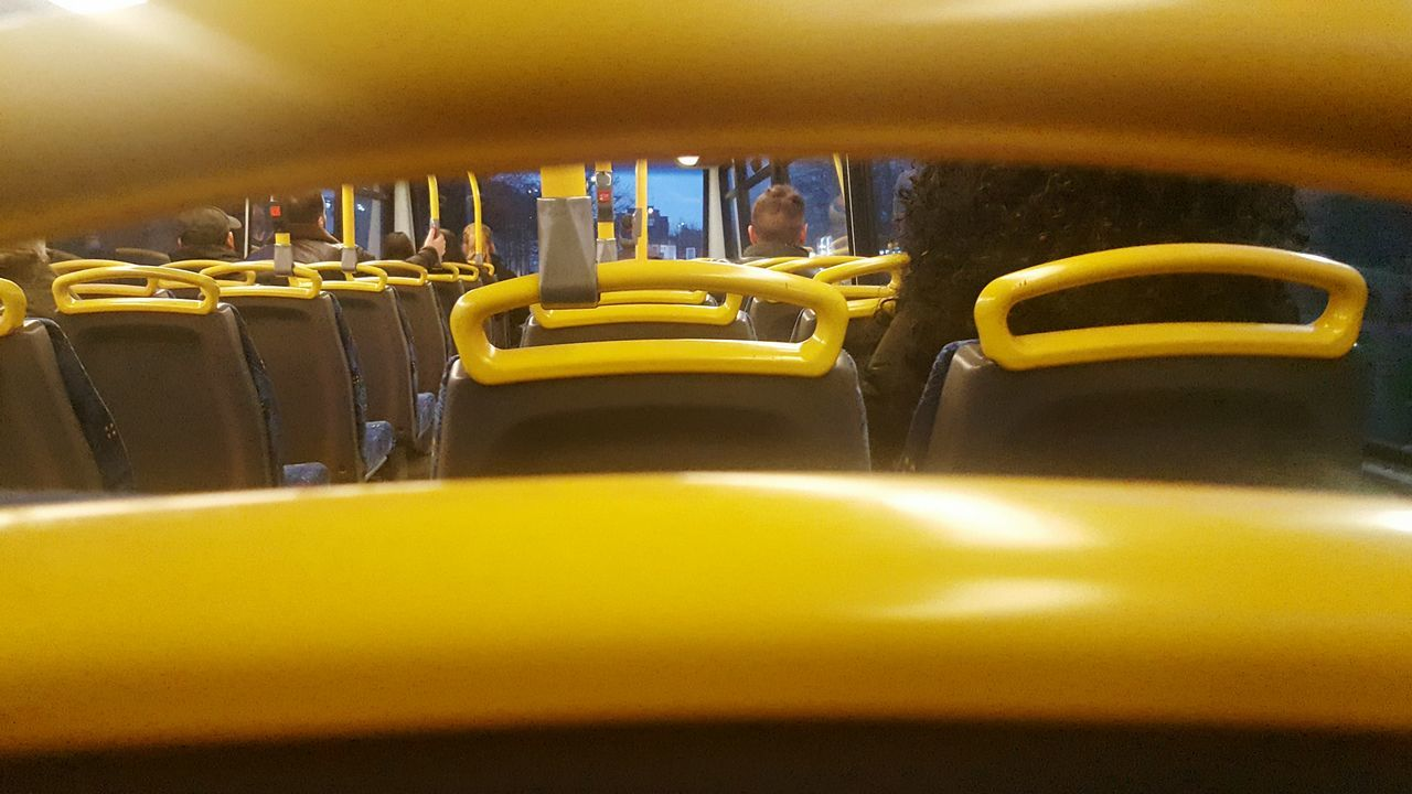 yellow, in a row, transportation, no people, seat, day, indoors, close-up