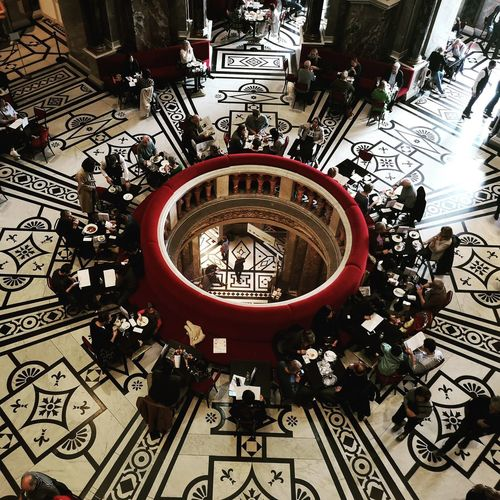 High angle view of people on tiled floor