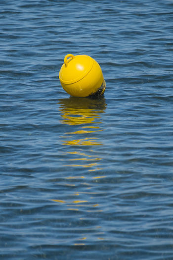Yellow buoy in water