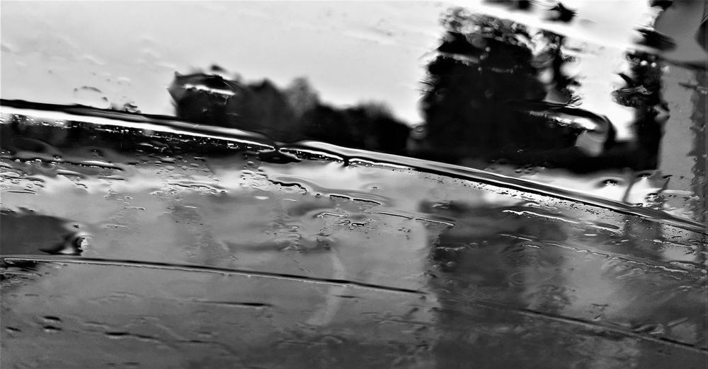 Inside the car while it's raining ... The Week On EyeEm By The Car Car Glass - Material Journey Nature Outdoors Rain RainDrop Rainng Reflection Sky Transportation Travel Water Wet Window Windshield