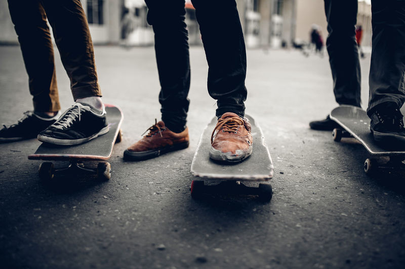 Low section of men on skateboards