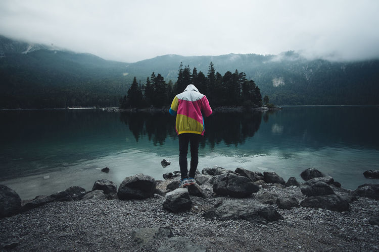Eibsee Zugspitze Alpen See Alpensee Reflection Human Representation Menschen Mood Moody Sky Mist Real People Lake Beauty In Nature Nature Fog Rear View One Person Standing Mountain Germany Hiking Roaming Jacket Traveling