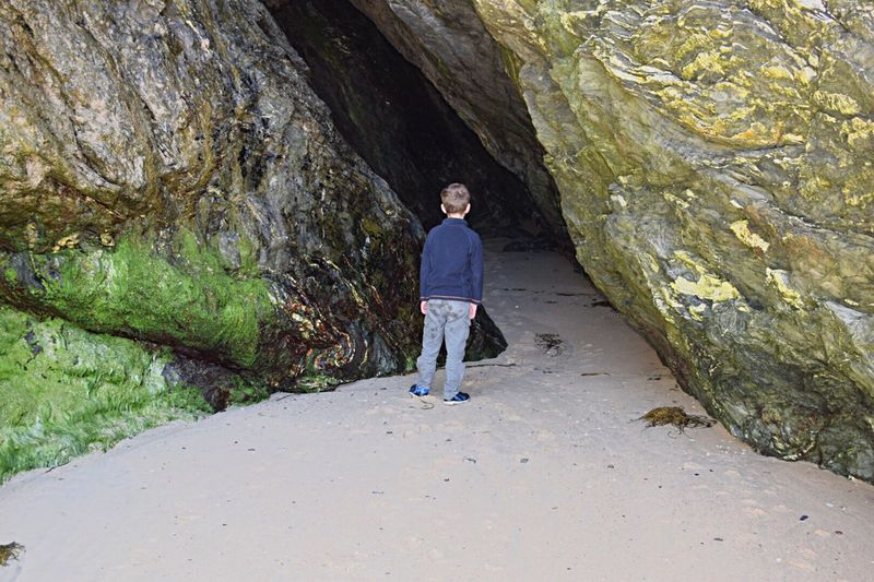 One Child Exploring The Unknown Full Length Rock - Object Exploring Nature Cave Formations Cave Entrance Finding Caves Beach Life Family Time Family Matters Entering Darkness Cornwall Cornish Life Cornish Landscape Nature On Your Doorstep Lost In The Landscape