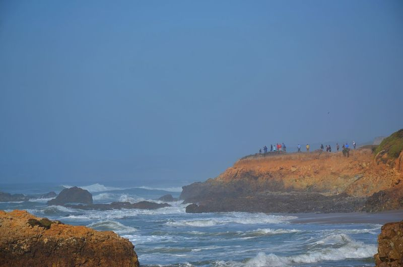 California Coast People In The Distance Whale Watching Rocky Coastline Beauty In Nature Hazy Summer Day On The Co Marine Layer Real People Travel Destinations