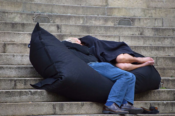 Man and woman relaxing, sleeping on bean bag chair in the street stairs Chair Man Pillow Romantic Stairs Steps Adult Bean Bag Black Black Color Day Lifestyles Men Outdoors People People And Places People Photography Real People Relaxation Relaxing Moments Relaxing Time Romantic Place Sleeping Stair Street Stories From The City This Is Aging EyeEmNewHere This Is Family Focus On The Story Modern Hospitality Creative Space #urbanana: The Urban Playground Summer In The City