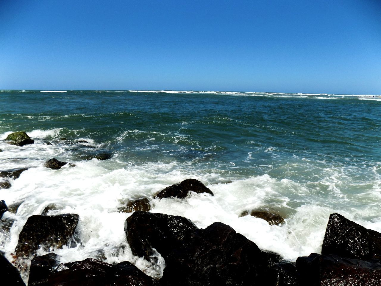 sea, horizon over water, water, clear sky, scenics, wave, outdoors, splashing, nature, sky, beauty in nature, day, motion, no people