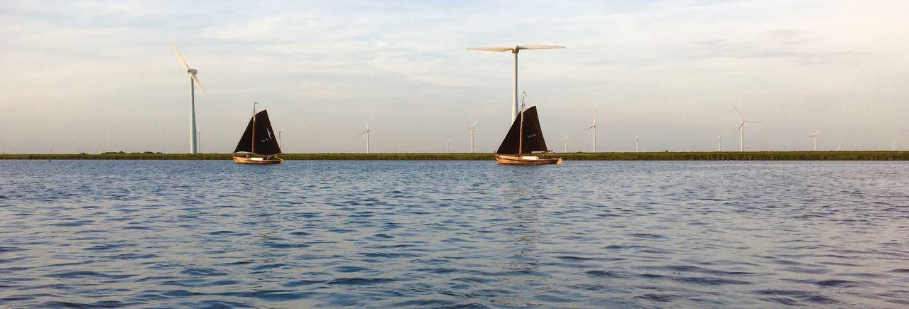 Antique fish sailboat Windmills Cloud - Sky Day Mode Of Transportation Nature Nautical Vessel No People Outdoors Sailboat Sailing Sailing Ship Scenics - Nature Sea Ship Sky Transportation Water Waterfront Yacht