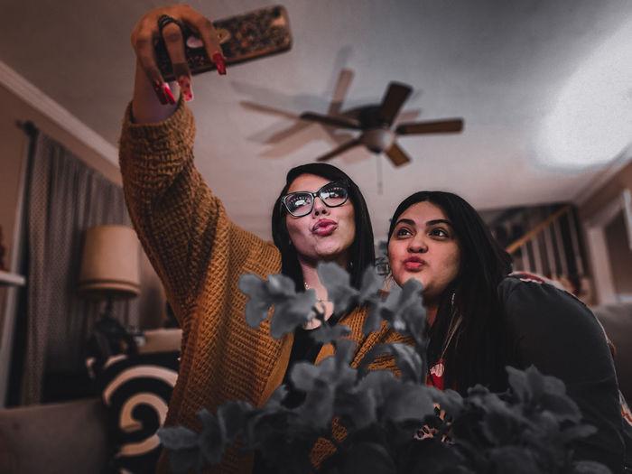 Portrait of hispanic women taking a selfie