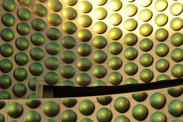 Accent Architectural Detail Architecture Backgrounds Building Exterior Building Story Close-up Day Dots Exterior Full Frame Green Color Green Dots Green Yellow Indoors  Large Group Of Objects Multi Colored No People Polka Dots  Sunlight Urban Urban Geometry Urban Photography Walk Trough Wall