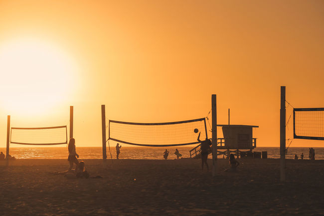 girls playing beach volley at Hermosa beach at sunset Dusk Los Angeles, California Pacific Ocean Pacific Coast Vacations Travel Destinations Fun Playful Lifeguard Hut Lifeguard  Beach Beach Life Leisure Activity Leisure Young People Joyful Joy Sunset Sun Beach Volleyball Sea Sunset Beach Water Sand Net - Sports Equipment Lifeguard  Silhouette Playground Shore
