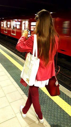 People And Places Public Transportation Lifestyles Casual Clothing Leisure Activity Railroad Station Platform Transportation Holding Girl Urban Lifestyle Urban Life Selfie Portrait Metro Station Metro Streetphotography Street Photography Portrait Embrace Urban Life