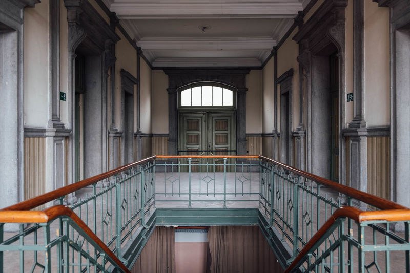 Architecture Indoors  Built Structure No People Ceiling Door Empty Entrance Window Architectural Column Steps And Staircases Building History Urbex Urbexphotography The Past Urbexexplorer Absence Railing Arcade Courthouse