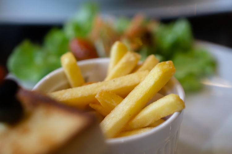 Close-up of fries and vegetables in plate