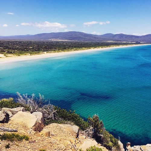 Aqua ocean scene Sea Blue Sky Australia Tasmania Sand Reef