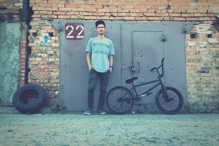 22 Transportation Mode Of Transport Bicycle Casual Clothing Lifestyles Portrait Architecture Brick Wall Front View Stationary Travel Person Young Adult City Garage Rims Nsk Novosibirsk Ride Shadow Conspiracy Life Oneday One